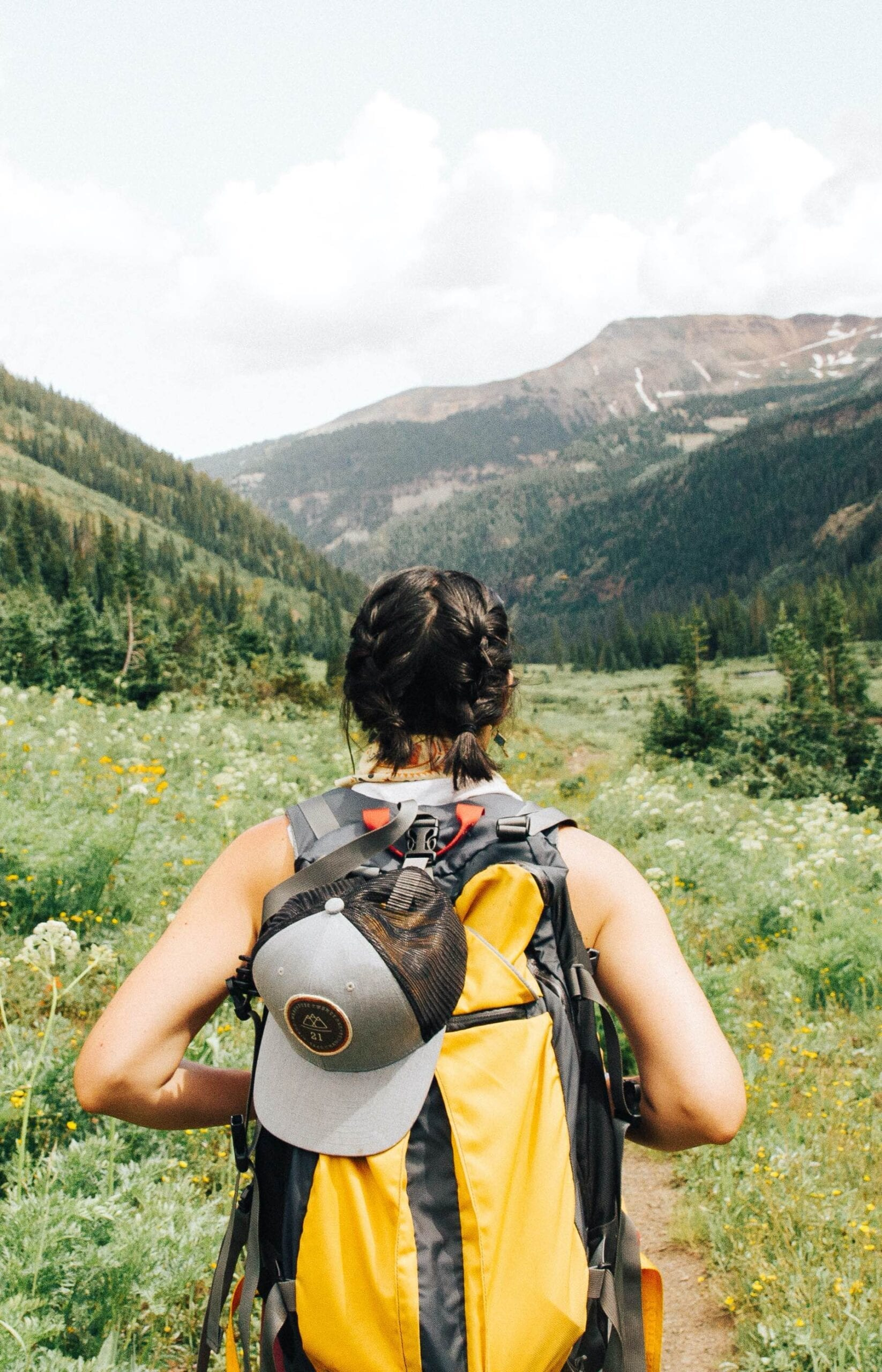 search for change lady hiking with a backpack